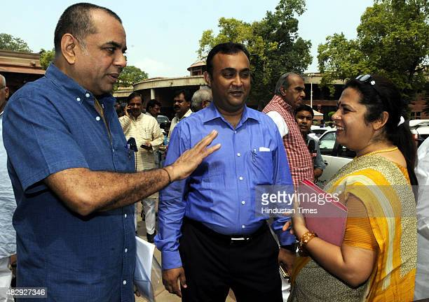 Meenakshi Lekhi talking with Bollywood actor and MP Paresh Rawal after attending the BJP Parliamentary Board Meeting during the Monsoon Session of...