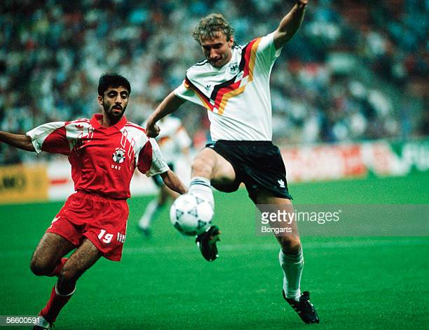 Meer Abdulrahman of United Arab Emirates and Rudi Voeller of Germany battle for the ball during the World Cup group D match between Germany and...