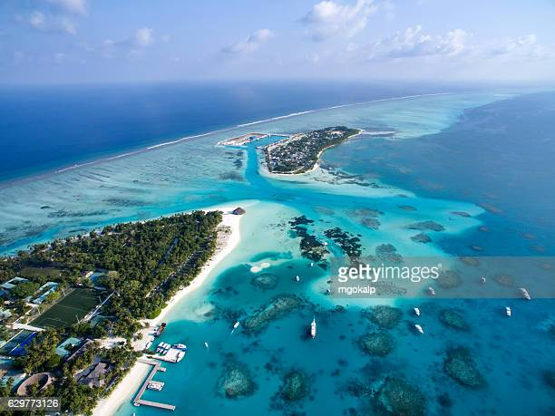meeru and a dhiffushi islands - male maldives stock pictures, royalty-free photos & images
