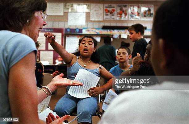 me/esol Jahi Chikwendiu/TWP Vyvy Pham is eager to answer a question concerning religious tolerance in a class led by substitute teacher Mary Frank at...