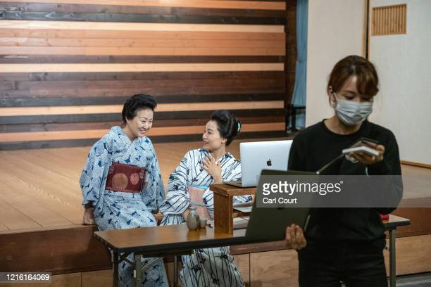 Meet Geisha staff member Tamaki Nishimura prepares the next meeting as Masako Takezawa the owner of Matsuyoshi Geisha House and chairperson of the...