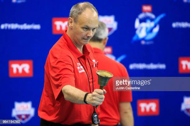A meet official rings the bell lap for the men's 800m freestyle final at the 2018 TYR Pro Series on July 8 2018 in Columbus Ohio