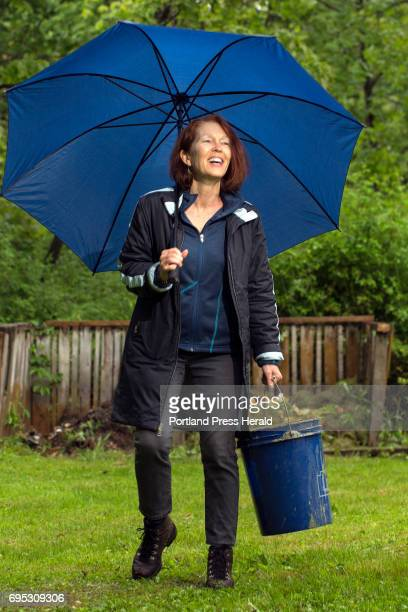 Meet: Susan Webster holds a compost bucket in light rain near her compost piles at her Portland home.