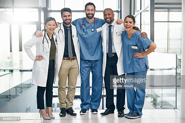 meet the members of your medical team - group of doctors stock pictures, royalty-free photos & images