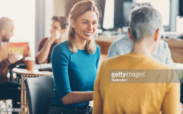 meeting at cafe - mid adult stock pictures, royalty-free photos & images