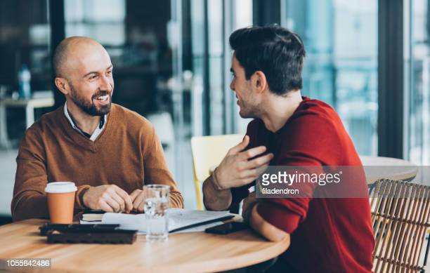meeting at cafe - talking stock pictures, royalty-free photos & images