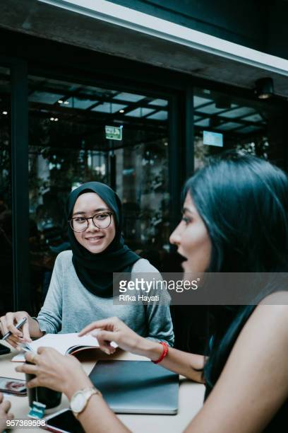 meeting at cafe - rifka hayati stock pictures, royalty-free photos & images