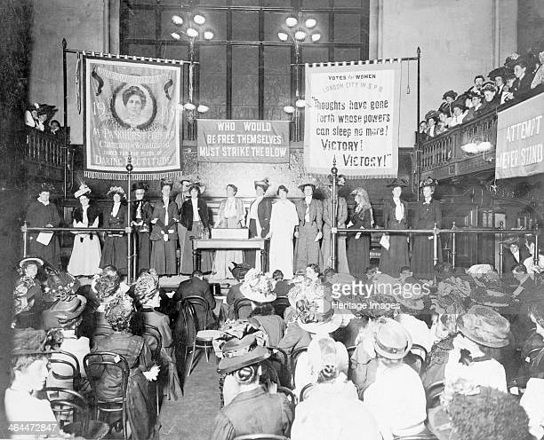 A meeting at Caxton Hall prior to the 'Rush the House of Commons' demonstration October 1908 Senior WSPU figures address the meeting At the desk are...