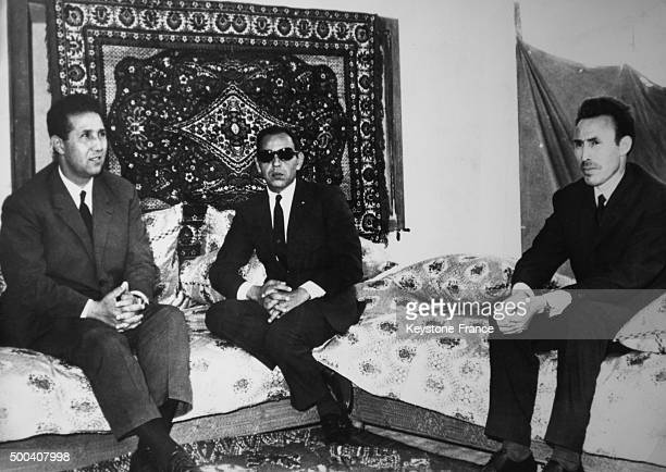 Meeting between Algerian President Ahmed Ben Bella and King Hassan II of Morocco the Algerian Minister of Defense Houari Boumediene on May 16 1965 in...