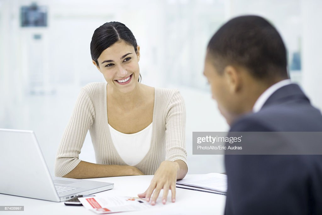 Meeting between professional and client, discussing document : Stock Photo