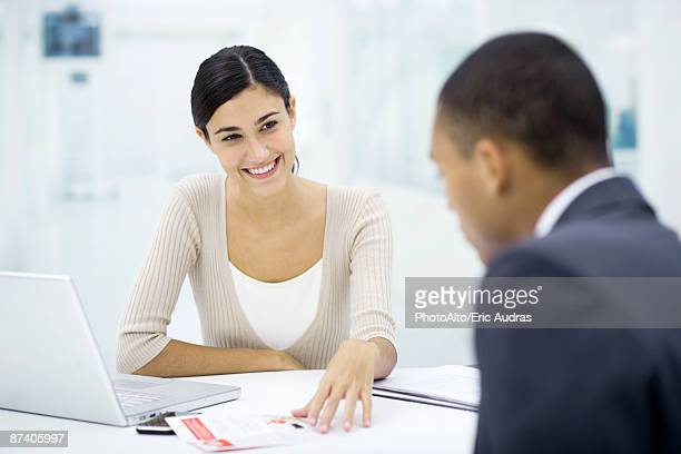 Meeting between professional and client, discussing document