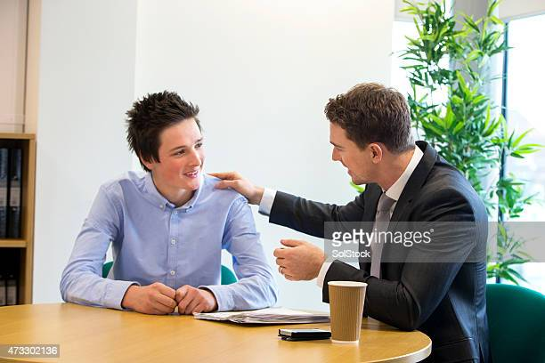 meeting between student and teacher - teen awards stock photos and pictures