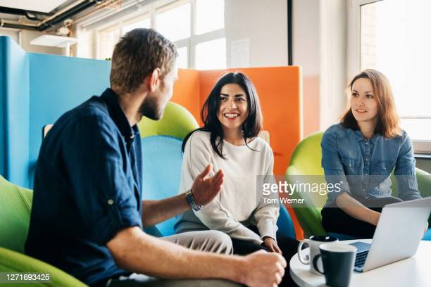 meeting between three team leaders in office - diversity stock pictures, royalty-free photos & images