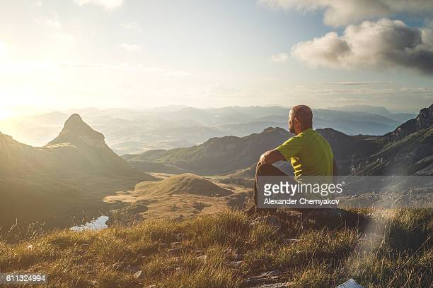 meeting dawn on top of the mountain - hill stock pictures, royalty-free photos & images