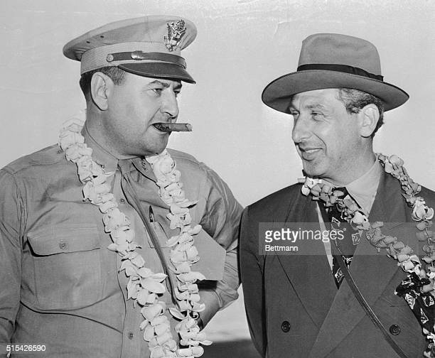 Meeting here while en route to the Able Day Atom Bomb Test at Bikini Atoll are Major General Curtis E LeMay cigar chewing Chief of the B29 attacks on...