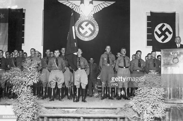 Meeting of the Chilean Nazi party, circa 1940. Present at the meeting are: German industrialist Count Matuschka of the Siemens-Schuckert company,...