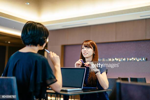 meeting of two successful japanese businesswomen - mission statement stock photos and pictures
