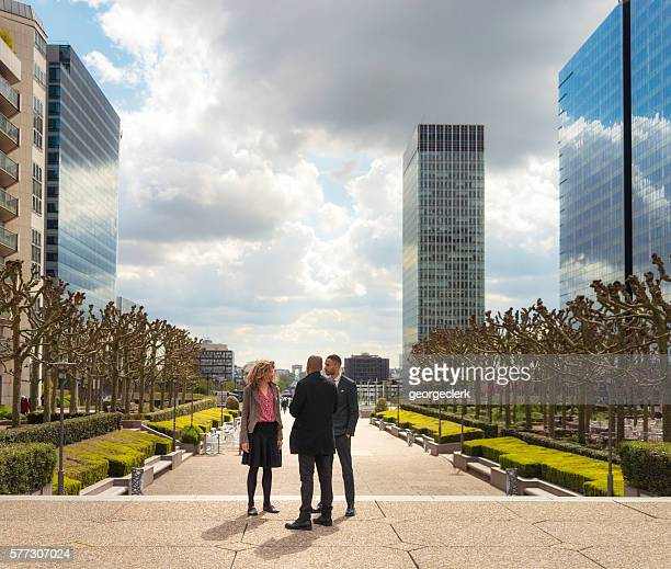 Meeting outdoors in La Defense business district of Paris