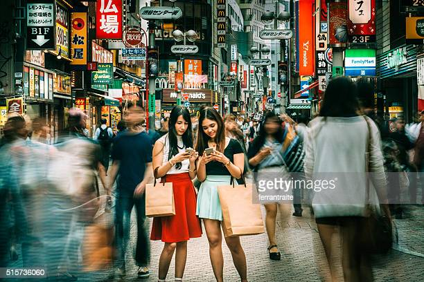 meeting point shibuya crossing in tokyo - advertising_campaign stock pictures, royalty-free photos & images