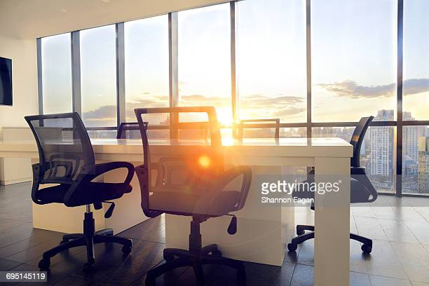 Meeting room with cityscape sunflare and sunset