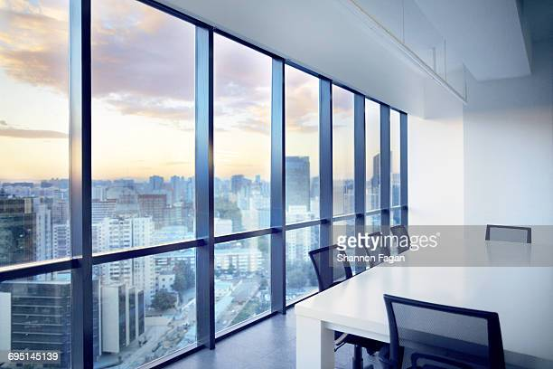 meeting room with window view of cityscape clouds - finestra foto e immagini stock