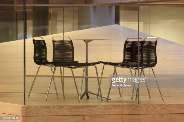 Meeting table and chairs on first floor with timber pyramid behind IBC Innovation Factory Kolding Denmark Architect schmidt hammer lassen architects...