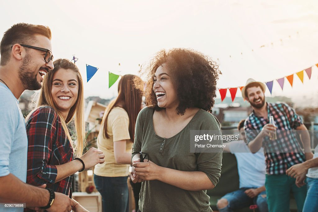 Meeting the friends on the rooftop : Stock Photo