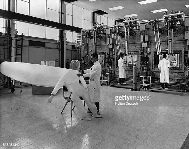 Meeting the increasing demand for radiosotopes. A photograph taken during a press visit to the Radiochemical Centre of the UK Atomic Energy Authority...