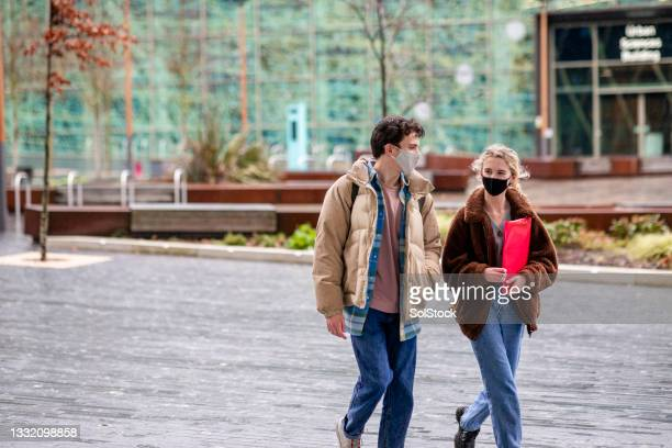 meeting up on campus - flatten the curve stock pictures, royalty-free photos & images