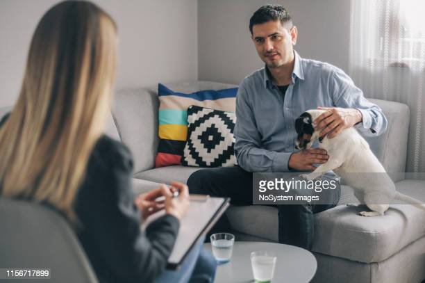 meeting with counsellor at home - monogamous animal behavior stock photos and pictures