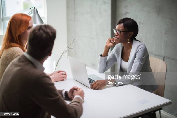 meeting with financial advisor - ginger banks stock pictures, royalty-free photos & images