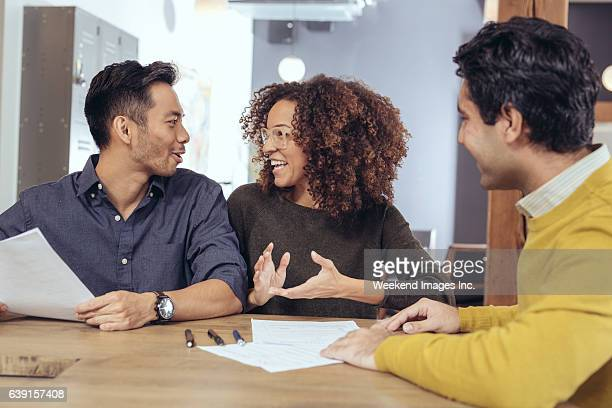 meeting with home designer - passing giving stock photos and pictures