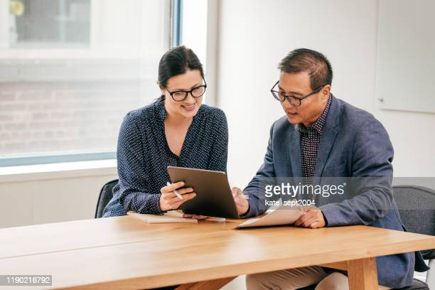meeting with lawyer and financial advisor - organised group stock pictures, royalty-free photos & images