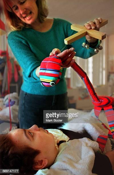 MEFairviewPuppet061198MB––––Sue Barker a Compensatory Education teacher at the Fairview Developmental Center in Costa Mesa dangled a puppet over...