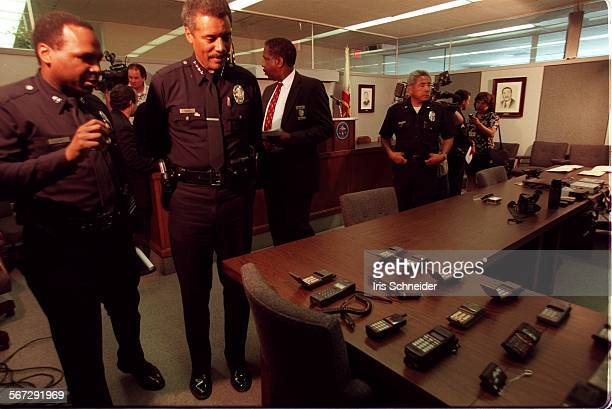 MEFake cops20918ISChief Bernard Parks looks over confiscated guns scanners ammunition and other items taken after the arrest of two men last night...