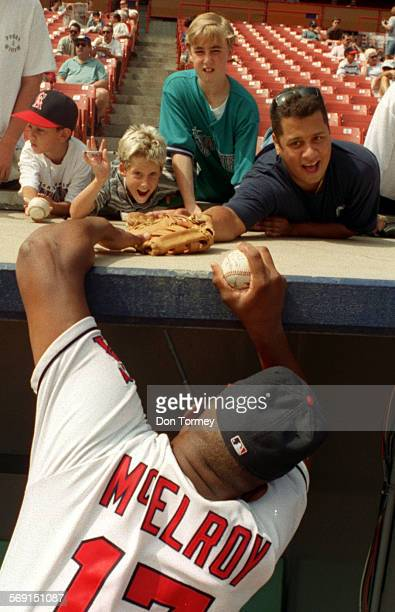 Fans.Stretch.DT––Angels pitcher Chuck McElroy, bottom, stretches to retrieve and returm items he was autographing for Angel fans who turned out for...