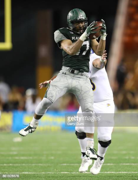 Meffy Koloamatangi of the Hawaii Rainbow Warriors intercepts a lateral to seal the victory for Hawaii during the fourth quarter of the game against...