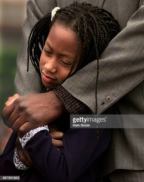 MEFloJoDaughter052199MB–––Mary Joyner stood quietly with her father Al Joyner at the unveiling of a statue of her mother Florence Griffith Joyner...