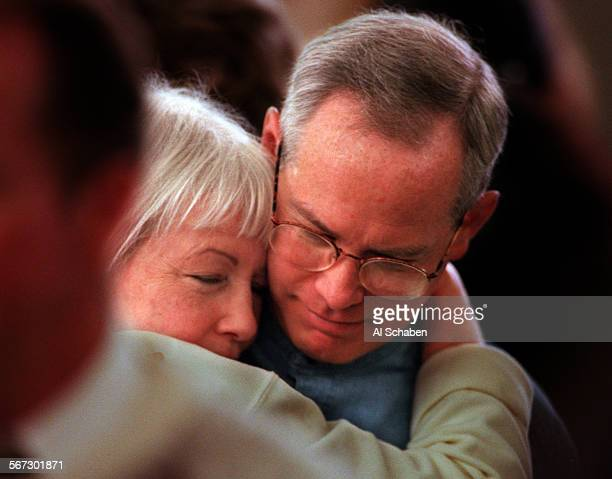 MEfuneralhug0104AS––NEWPORT BEACH––Patricia Hagerman left hugs Dave McCallum of Dallas Texas following funeral services for her husband William...