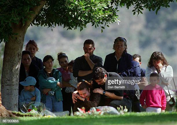 Funeral.Segura.DB.022799––Orange–– In the company of relatives and friends, Maria Lucia Rios and her husband Alberto Segura spend the last agonizing...