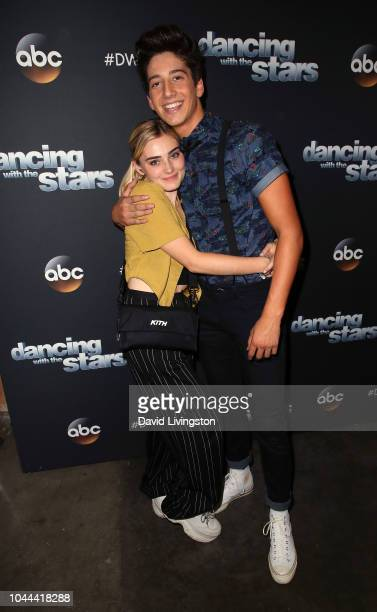 Meg Donnelly and Milo Manheim pose at Dancing with the Stars Season 27 at CBS Televison City on October 1 2018 in Los Angeles California