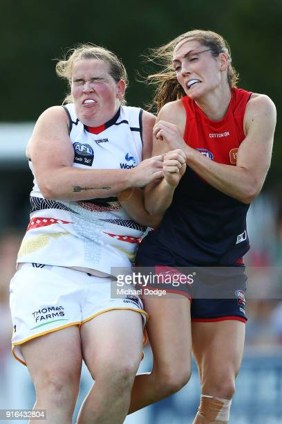 Meg Downie of the Demons and Sarah Perkins compete for the ball during the round two AFLW match between the Melbourne Demons and the Adelaide Crows...