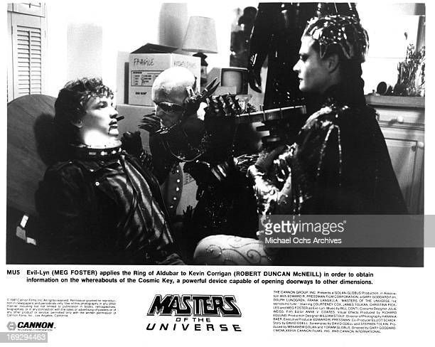 Meg Foster applies the Ring of Aldubar to Robert Duncan McNeill in a scene from the film 'Masters Of The Universe' 1987