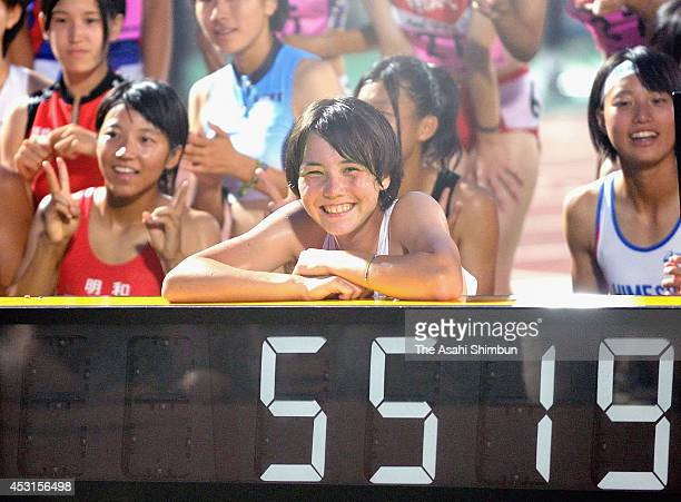 Meg Hemphill of Kyoto Bunkyo high school poses for photographs as he achives a new junior record of Women's Heptathlon during the Inter High School...