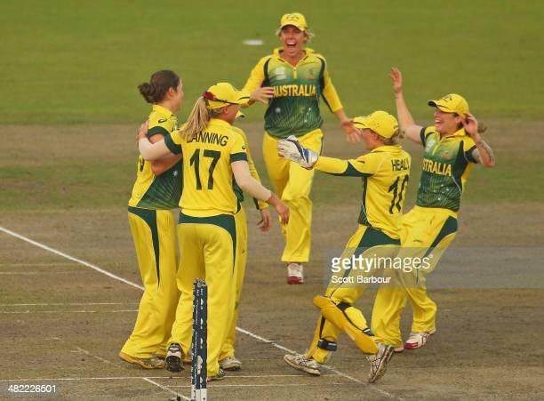 Meg Lanning Alyssa Healy Rene Farrell and the Australian team celebrate winning the ICC Women's World Twenty20 Bangladesh 2014 1st SemiFinal match...