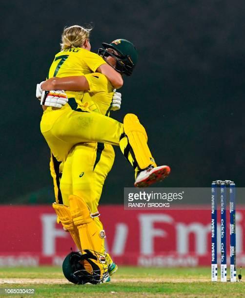 Meg Lanning and Ashleigh Gardner of Australia celebrate winning the ICC Women's World T20 final cricket match between Australia and England at Sir...