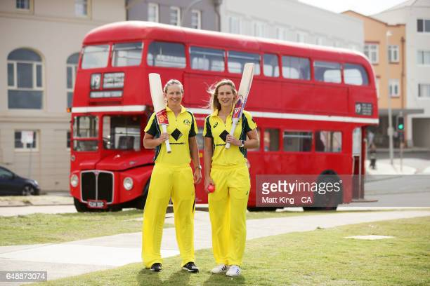 Meg Lanning and Ellyse Perry of Australia pose in front of a London bus during the Women's Ashes Schedule Launch at Bondi Beach on March 7 2017 in...