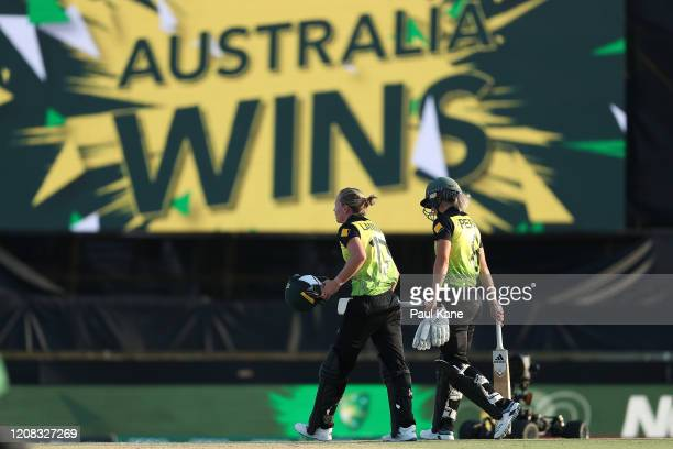 Meg Lanning and Ellyse Perry of Australia walk from the field after winning the ICC Women's T20 Cricket World Cup match between Australia and Sri...