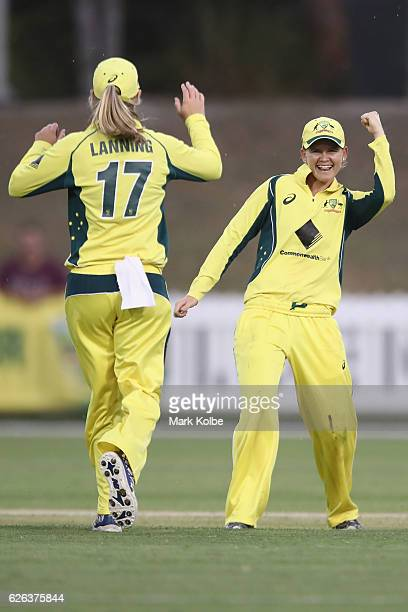 Meg Lanning and Jess Jonassen of Australia celebrate after Jess Jonassen ran out Lizelle Lee of South Africa during the women's one day international...