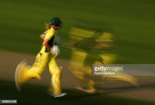 Meg Lanning and Nicole Bolton of Australia make runs during game two of the women's one day international series between Australia and India at...